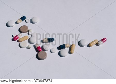 Many Different Tablets On A Light Background. Vitamins For Oral Administration.