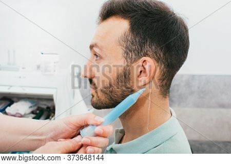 Process Of Molded Individual Hearing Aid Earmolds. A Man, Having Procedure Making Customized To A Pe