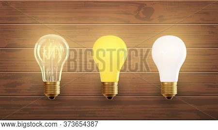 Set Of Electric Lamps, Edison, Tungsten, Fluorescent And Led. Isolated On A Wood Background. Incande