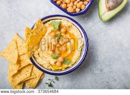 Directly Above Shot Of Hummus Or Humus In Bowl On Table. Vegan Plant Based Food. Colorful Hummus Bow