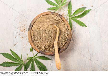 Hemp Flour  In Wooden Bowl.  Copy Space. Cbd Cannabis.hemp Flour In Wooden Bowl, Powder In Spoon, Ca