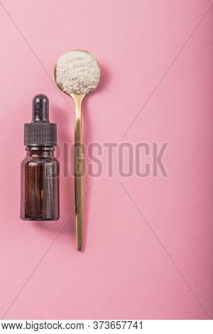 Hyaluronic Acid Bottle. Collagen Solution And Collagen Powder In Spoon.collagen Word In Wooden Lette