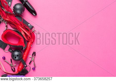 Intimate Sex Games. Bdsm Tools Dildo Vibrator, Gag, Nipple Clamps, Handcuffs, Whip And Other On Red