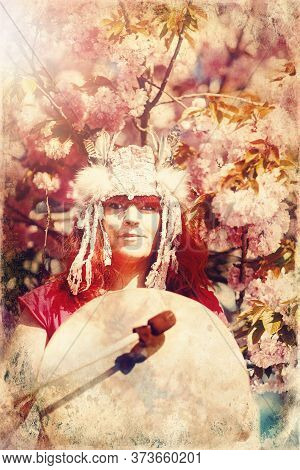 Beautiful Shamanic Girl Playing On Shaman Frame Drum In The Nature. Old Photo Effect.