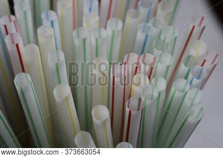 Colored Plastic Straws, Top View Details For Plastic Background
