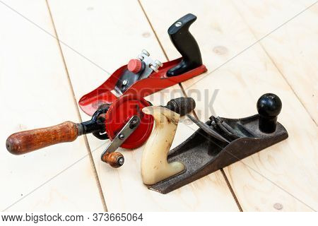 Joinery – Old Wooden Plane, Wood Polishing Tool In A Workshop Of The Carpenter, Retro Concept.
