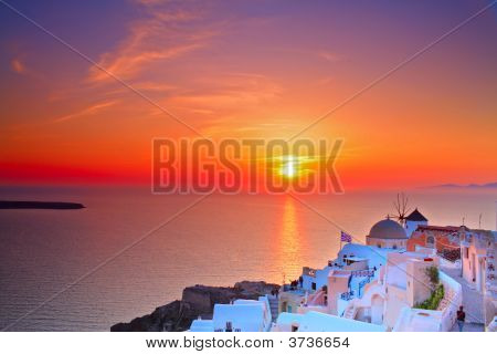 Sunset In Oia Village On Santorini Island