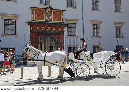 Vienna, Austria - July 11, 2015: White Horse Drawn Carriage Waiting In Front Of Hofburg Imperial Pal