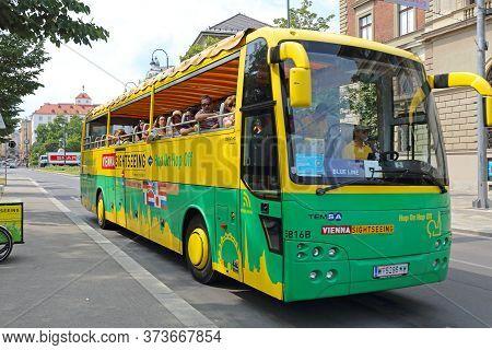 Vienna, Austria - July 12, 2015: Wien Sightseeing Tour Bus With Tourists In Vienna, Austria.