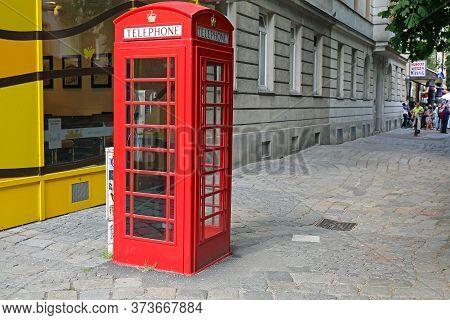 Vienna, Austria - July 12, 2015: Famous British Iconic Red Telephone Box Cabin In Vienna, Austria.