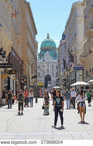 Vienna, Austria - July 11, 2015: Bunch Of Tourists At Kohlmarkt Shopping Street In Vienna, Austria.