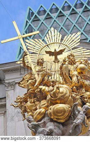 Vienna, Austria - July 12, 2015: Column Of Pest Plague Gold Monument Top At Graben Street In Vienna,