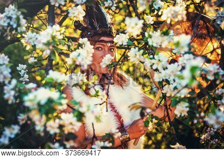 Beautiful Shamanic Girl Playing On Shaman Frame Drum In The Nature And Light Graphic Effect.