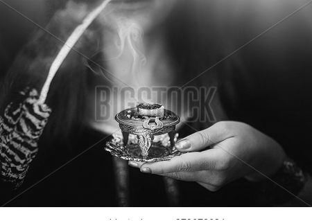Incense In A Woman Hand, Incense Smoke On A Blur Background.
