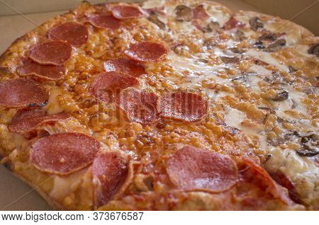 Delicious Fresh Made Pepperoni Pizza On Cardboard Box. Selective Focus