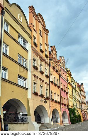 Facades Of Historic Tenement Houses With Arcades On The Market In The City Of Jelenia Gora In Poland