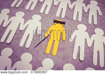Silhouette Of A Blind Disabled Man With A Cane And Glasses. A Yellow Lone Figure In The Middle Of Ot