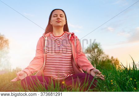 Yoga Outdoor. Happy Woman Doing Yoga Exercises. Yoga Meditation In Nature. Concept Of Healthy Lifest