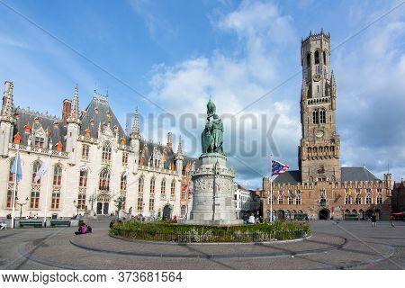 Market Square (grote Markt) And Belfort Tower In Bruges, Belgium