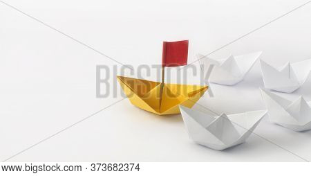 Leadership Concept. Red Flag Origami Yellow Paper Boat (ship) Leading The Other White Boats. One Lea
