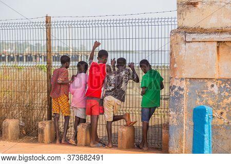 Bissau, Guinea-Bissau - January 5, 2020: group of African Kids in rural Guinea-Bissau
