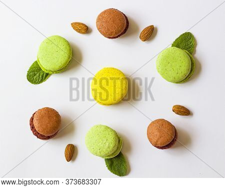 Macaroons Macaroons On A White Background With Mint. Peppermint. View From Above. Macaroons Lie In A