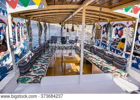Luxor, Egypt - Jan 28, 2020: Touristis  boats on the Nile river in Luxor city, Egypt