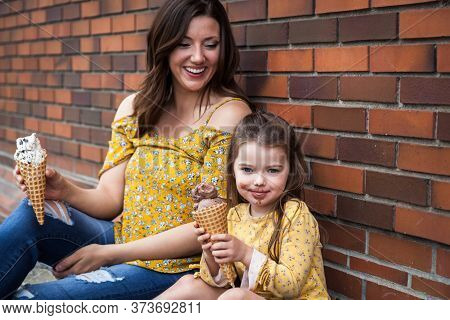 Mom And Daughter Eating Ice Cream