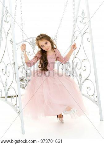 Portrait Of Beautiful Preteen Girl Swinging On Elegant Metal Swing Isolated On White Background, Cha