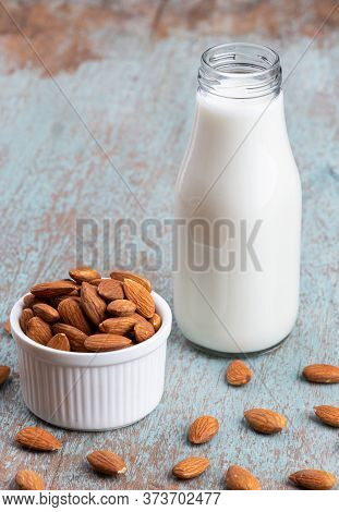 Close Up Glass Of Almond Milk With Almond Seeds. Almond Milk In A Glass With Almonds