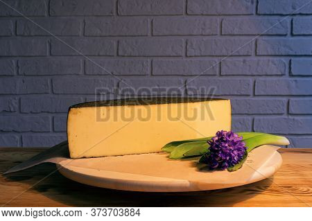 A Large Piece Of Aged Cheese With Spices