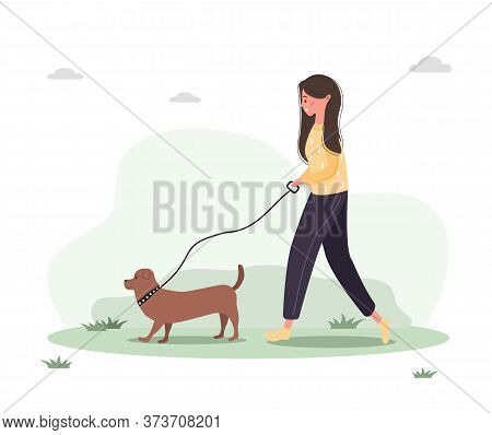 Young Woman Walks With Dog Through The Woods. Concept Happy Girl In Yellow Dress With Dachshund Or P