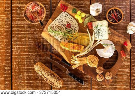 Cheese Board - Various Types Of Cheese Composition. Mix Cheese On Wooden Board With Grapes. Preparin