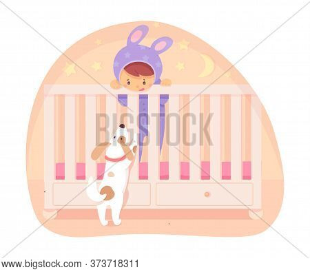 Little Baby In Jumpsuit With Long Cute Hare Ears Standing In Bed And Playing With Funny Curious Pupp