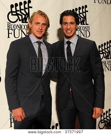 NEW YORK-SEPT. 24: New York Rangers Carl Hagelin and Michael Del Zotto (R) attend the Great Sports Legends Dinner for the Buoniconti Fund at the Waldorf-Astoria on September 24, 2012 in New York City.