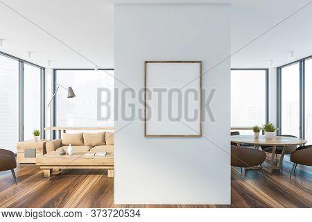 Interior Of Modern Living Room With Comfortable Beige Sofa Standing Near Coffee Table And Dining Roo