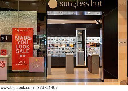 Townsville, Queensland, Australia - June 2020: Sunglass Hut Open For Business In Shopping Centre Pos