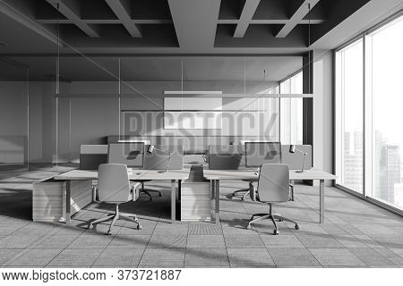 Interior Of Panoramic Open Space Office In Industrial Style With Gray Walls, Carpeted Floor, Columns