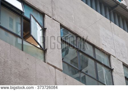 Window Opens From An Old Office Building