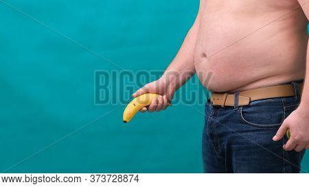 Old Limp Drooping Banana Hanging From Genital Area Of Clothed Unrecognizable Man, Impotence Erectile