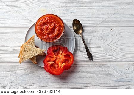 Ajvar Or Pindjur Red Vegetable Spread Or Pepper Paprika And Tomato Mousse On A Wooden Table. Serbian