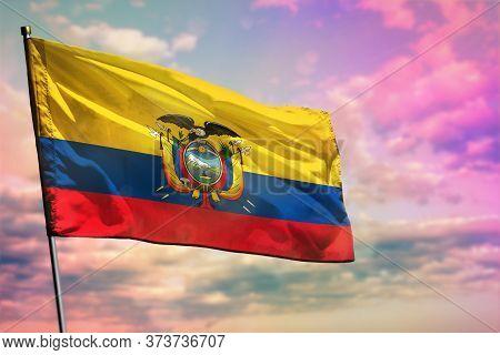 Fluttering Ecuador Flag On Colorful Cloudy Sky Background. Ecuador Prospering Concept.