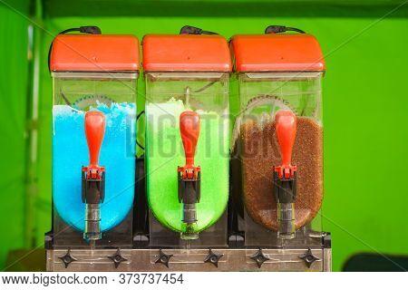 Slush Machine. Slushy Ice Made Colorful Drink Refreshing During Summer. Granita Distributor. Differe