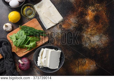 Traditional Greek Spanakopita Ingredients Filo Spinach Eggs Feta Top View On Dark Background Space F