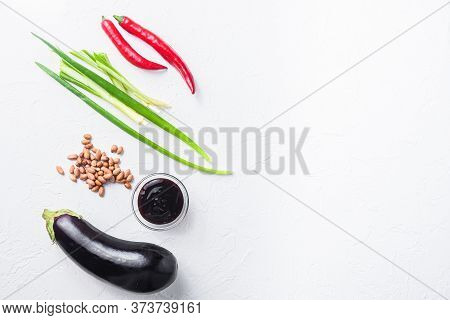Baked Aubergine Ingredients, For Cooking Or Grill Chili Pepper, Eggplant, Sauce, Nuts On White Backg