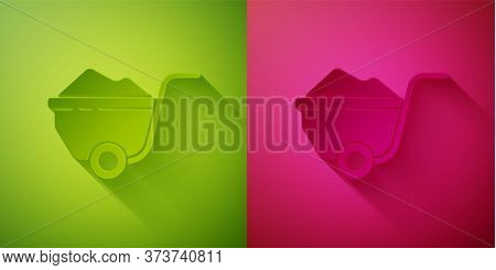 Paper Cut Wheelbarrow With Dirt Icon Isolated On Green And Pink Background. Tool Equipment. Agricult