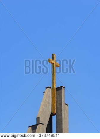 Golden Cross On A Top Of Christian Gospel Baptist Church Against The Blue Sky On A Sunny Day. Faith,