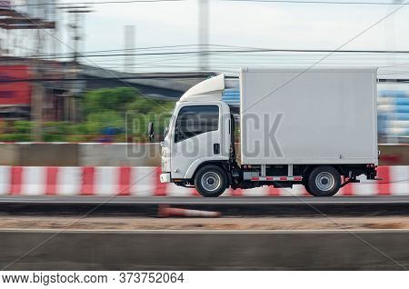 Motion Image Of A Small White Truck For Road Running Transportation