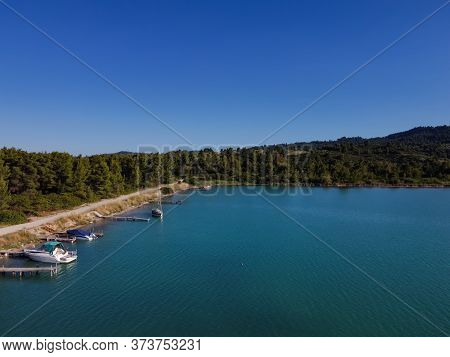 Mediterranean Greek Landscape Coastal Drone Shot With Moored Boats. Aerial Top View Of Glarokavos La