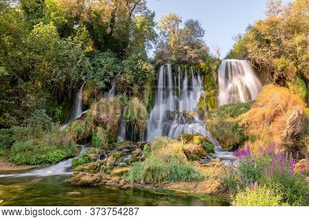 Kravica waterfall on Trebizat river in Bosnia and Herzegovina. Beautiful cascade waterfall in forest